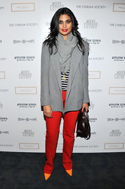 Rachel bundled up in a silky gray scarf with her blazer and bold red slacks.