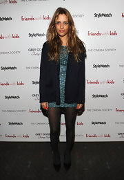 Charlotte Ronson tempered her the short hemline of her dress with a long cardigan.