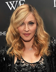 Madonna wore her hair in soft waves with a sexy side part at a screening of 'W.E.'