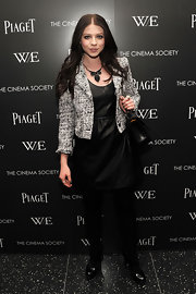 Michelle Trachtenberg wore a leather dress under her tweed cropped jacket for the 'W.E.' screening.