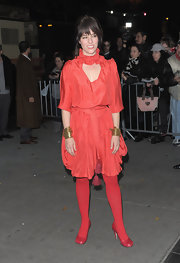 Parer Posey certainly was going for a unique look in a red dress with matching tights and heels at the 'W.E.' screening.