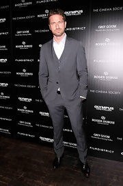 Gerard Butler opted for a classic three-piece, peak lapel suit for his look at the screening of 'Olympus Has Fallen.'