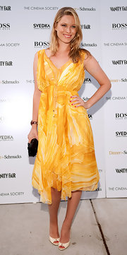 Kiera glowed in a sunny yellow day dress with ivory pumps.