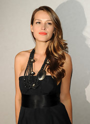 Petra wears a black beaded statement necklace to add some pizazz to this simple chic black dress.
