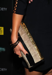 Alice Cage paired her black cut out dress with an embellished envelope clutch.