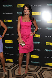 Kimberly paired her nude pumps and box clutch with a hot pink dress.