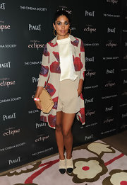 Rachel Roy paired her summer outfit with a quilted leather shoulder bag.