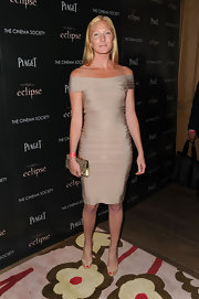 Maggie Rizer paired her champagne colored bandage dress with gold accessories, which complemented her golden blonde hair.