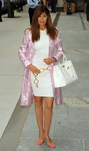 Carol Alt paired her white dress and pink overcoat with a classic Birkin bag.