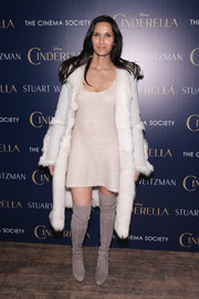 Padma Lakshmi completed her monochromatic ensemble with a pair of taupe over-the-knee boots.