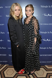 Ashley Olsen attended a Cinema Society screening of 'Midnight in Paris' wearing a loose-fitting sheer polka-dot gown.