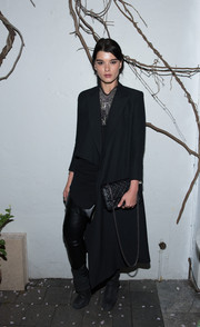 Crystal Renn continued the edgy vibe with a pair of black wedge boots.