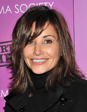 Gina Gershon wore her hair in shoulder-length wispy layers when she attended the screening of 'Dirty Girl.'