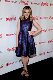 Chloe Grace Moretz looked ultra-feminine in her A-line dress with strappy black heeled sandals.