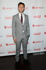Joseph Gordon-Levitt chose a plaid two-button, notch-lapel gray suit for his dapper look at CinemaCon.