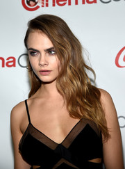 Cara Delevingne wore her long hair down with edgy-chic waves when she attended the CinemaCon Big Screen Achievement Awards.
