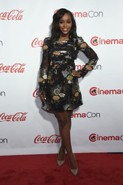 Aja Naomi King attended the CinemaCon Big Screen Achievement Awards wearing a cute floral mini dress.