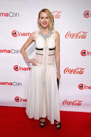 Naomi Watts went for boho glamour in a sleeveless white Miu Miu gown with a lace midsection and shoulders at the CinemaCon Big Screen Achievement Awards.