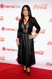 Salma Hayek looked effortlessly chic in a black Bottega Veneta dress with an embellished skirt and sheer panels at the CinemaCon Big Screen Achievement Awards.