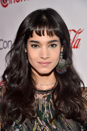 Sofia Boutella wore flowing waves with her signature baby bangs when she attended the CinemaCon Big Screen Achievement Awards.