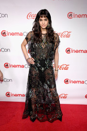 Sofia Boutella sizzled on the red carpet in a sheer, embellished black gown by Valentino at the CinemaCon Big Screen Achievement Awards.