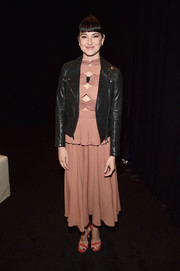 Shailene Woodley gave her dress an edgy finish with a black leather jacket.