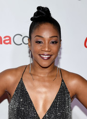 Tiffany Haddish styled her hair into an elaborate top knot for the 2018 CinemaCon Big Screen Achievement Awards.