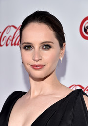 Felicity Jones wore her hair in a simple updo at the 2018 CinemaCon Big Screen Achievement Awards.