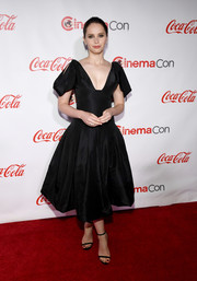 Felicity Jones polished off her look with black slim-strap sandals by Jimmy Choo.