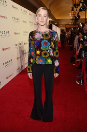 Saoirse Ronan amped up the '70s vibe with a pair of black bell-bottoms.