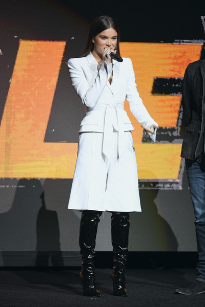 Hailee Steinfeld added major edge with a pair of black patent over-the-knee boots.