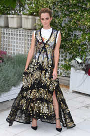 Emma Watson was all about cool glamour in a sheer black and gold gown layered over a graphic tank, both by Louis Vuitton, at the 'Circle' photocall in Paris.