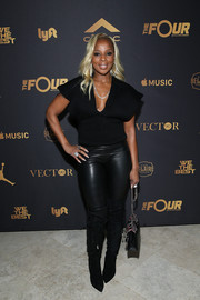 A pair of knee-high boots with lace-up sides completed Mary J. Blige's all-black look.
