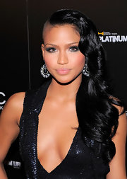 Showing off her edgy hair cut R&B singer Cassie attended the Ciroc Vodka party wearing a plunging beaded dress.