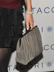 Betsey paired her ensemble with a grey suede clutch.