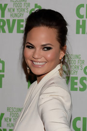 Chrissy Teigen looked chic and sophisticated with a teased French Twist.