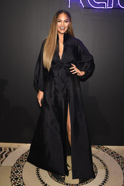 Chrissy Teigen looked regal in a flowing black gown by Azzi & Osta Couture at City Harvest: The 2019 Gala.
