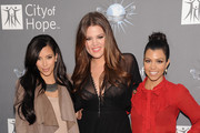 (L-R) Kim Kardashian, Khloe Kardashian and Kourtney Kardashian arrive for the City of Hope honoring Shelli And Irving Azoff with the 2011 Spirit of Life award at Universal Studios Hollywood on May 7, 2011 in Universal City, California.