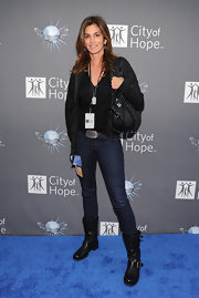 Cindy Crawford toughened her look at the Spirit of Life Awards with black leather motorcycle boots.