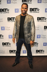 AJ Calloway added a nice touch to his classic jeans with a distressed blazer.