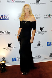 Shannon Tweed posed elegantly wearing an off-shoulder velvety gown at the City of Hope's Spirit of Life gala.