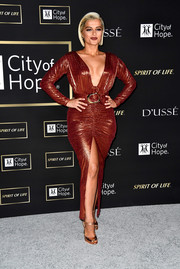 Bebe Rexha flaunted her assets in a curve-hugging bronze gown with a deep-V neckline at the City of Hope Gala.