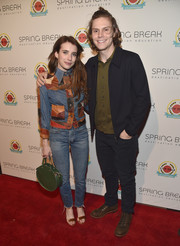 Emma Roberts accessorized with a circular green leather tote by Clare V.