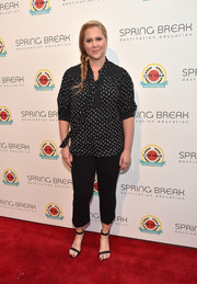 Amy Schumer kept it low-key in a black and silver print blouse at the City Year Los Angeles Spring Break.