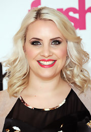 Claire Richards styled her bottle-blond tresses into airy curls for the launch of Fashion World 4.