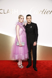 Lucy Boynton looked sweet in a pink ruffle-collar cocktail dress by Marc Jacobs at the Clash de Cartier launch.