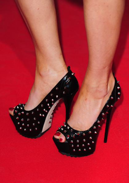 Hofit Golan posed for the photog's in a dangerous pair of studded peep-toe pumps. Her heels were obviously the stand out piece of her outfit and brought a killer edge to her dainty dress.