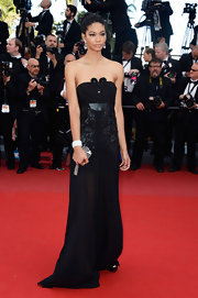 Chanel Iman showed off her long and lean figure in this strapless black gown with an embroidered bodice.