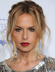 Rachel Zoe wore red lipstick with a patent leather finish at A Decade of Difference Gala. The bright shade worked perfectly with her gold and silver sequined gown.