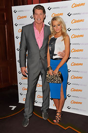 Hayley Roberts added a bit of sexiness to her look with a blue pencil skirt featuring a thigh-high slit.